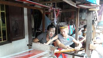 kids interact with local people in the textile village